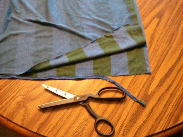 Cut tube along side seam and cut off stitching