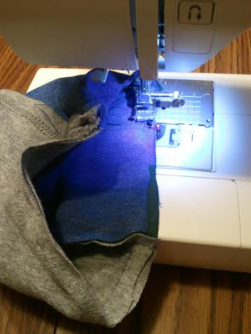 Stop sewing when there are 3 inches left then pull scarf through that hole