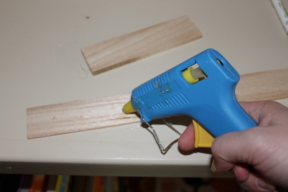 Step 2: Lots and lots of gluing.  I lost this beaut of glue gun during this project. She might have looked a little rough but she was with me for over 10 years. RIP blue glue gun. :)