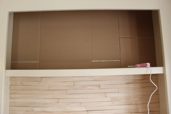 Step 1: Cut and place your cardboard against the back of your shelf.